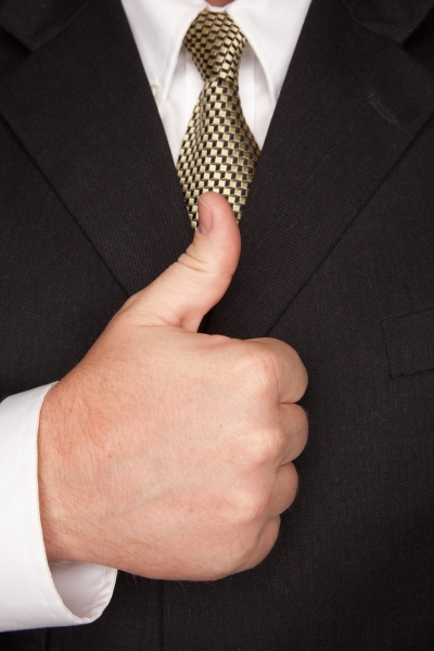 586411-businessman-gesturing-thumbs-up-with-hand