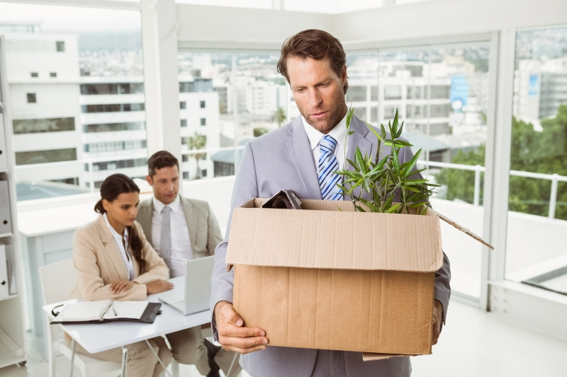 10209745-businessman-carrying-his-belongings-in-box